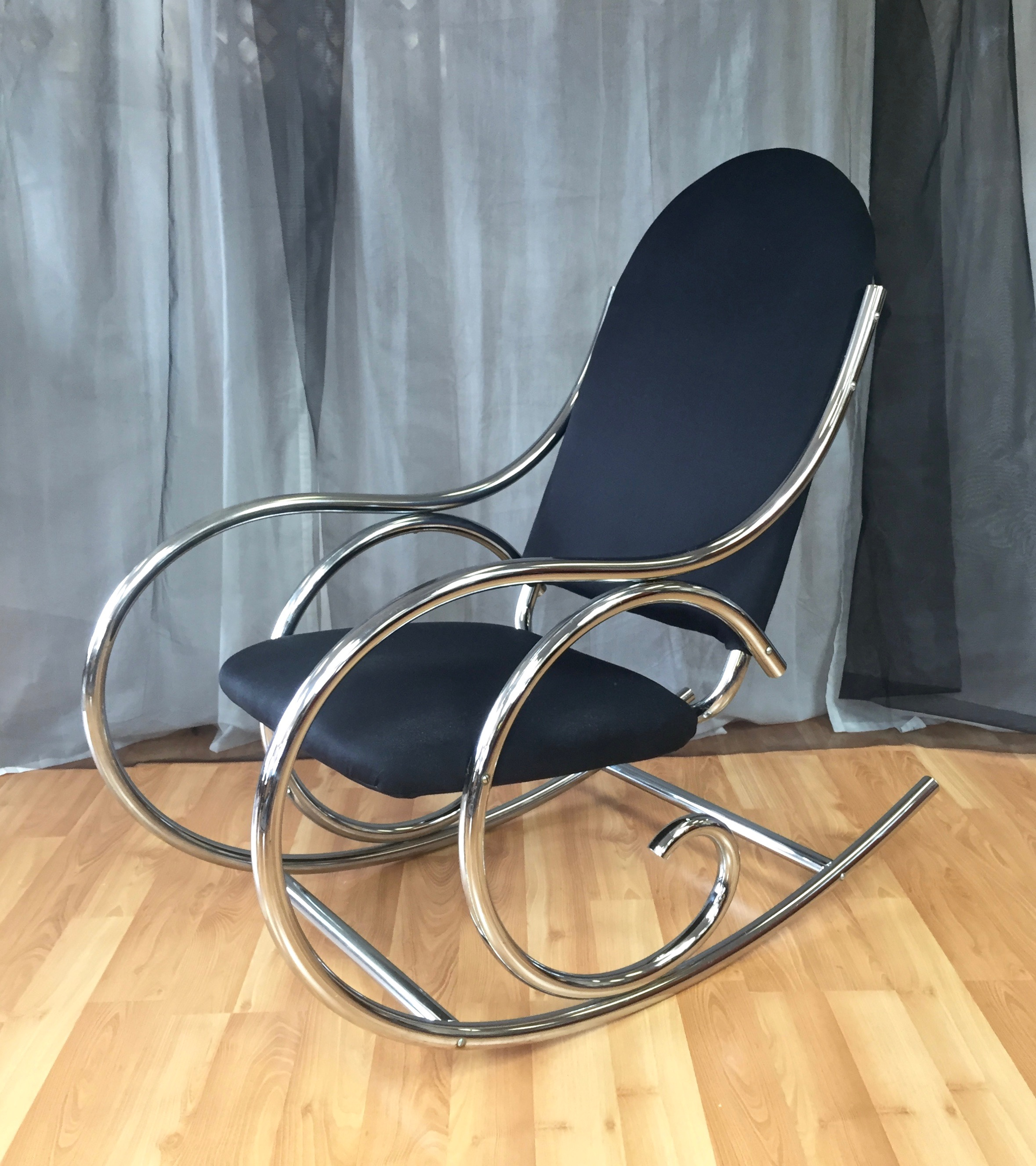 how to make a rocking chair not rock high for twins curvaceous upholstered chrome in the style