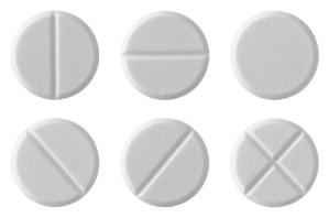 White tablet pills , isolated on white background