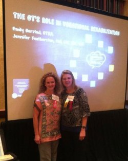 therapists in front of presentation on ots vocational role