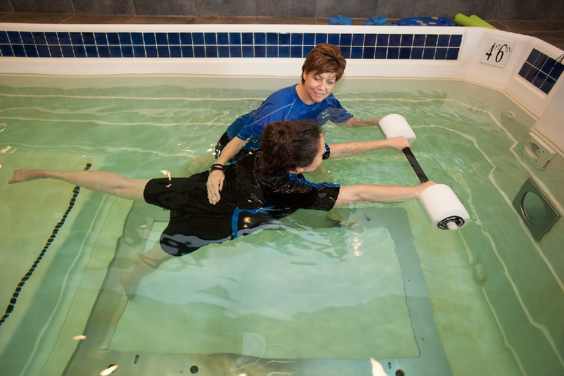 Aquatic rehab therapy in pool