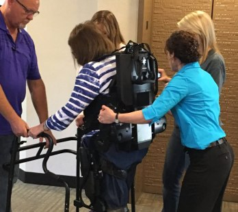 exoskeleton with therapists guiding