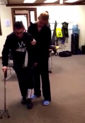 Man walking after brain injury