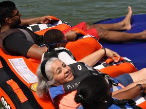 people rafting with rise adaptive sports group