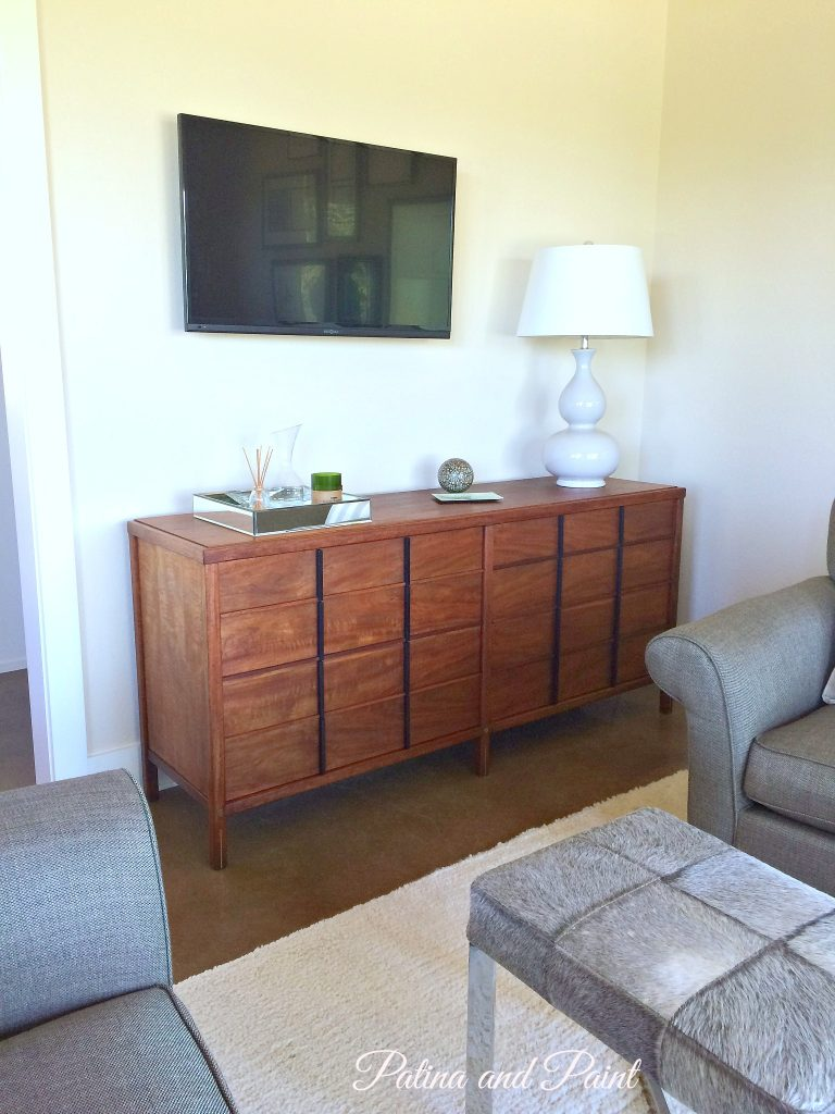 a friend and client of mine was looking for a mid century modern piece that could also serve as her tv cabinet and also provide storage