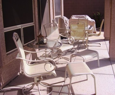 This image has an empty alt attribute; its file name is sling_replacements_agio_patio_chair_putty_CR_after-1.jpg