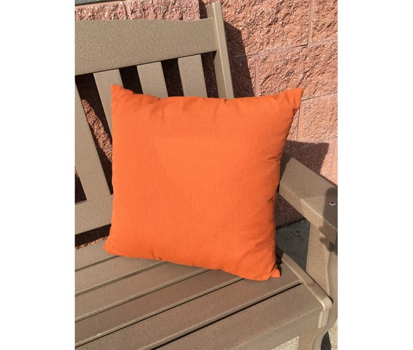 Twenty two inch orange pillow on a poly bench.