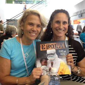 Brenda Kahn (L) and Patricia Newman at ALA celebrating the release of EBOLA: FEARS AND FACTS.