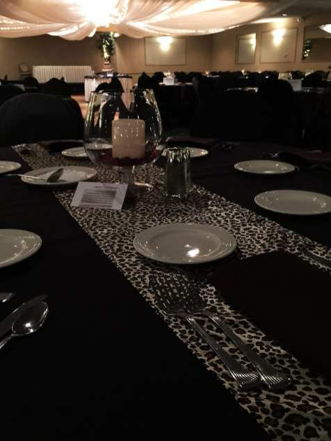Leopard table runner at wedding