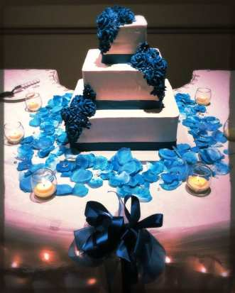 Fancy cake with blue flowers and ribbon