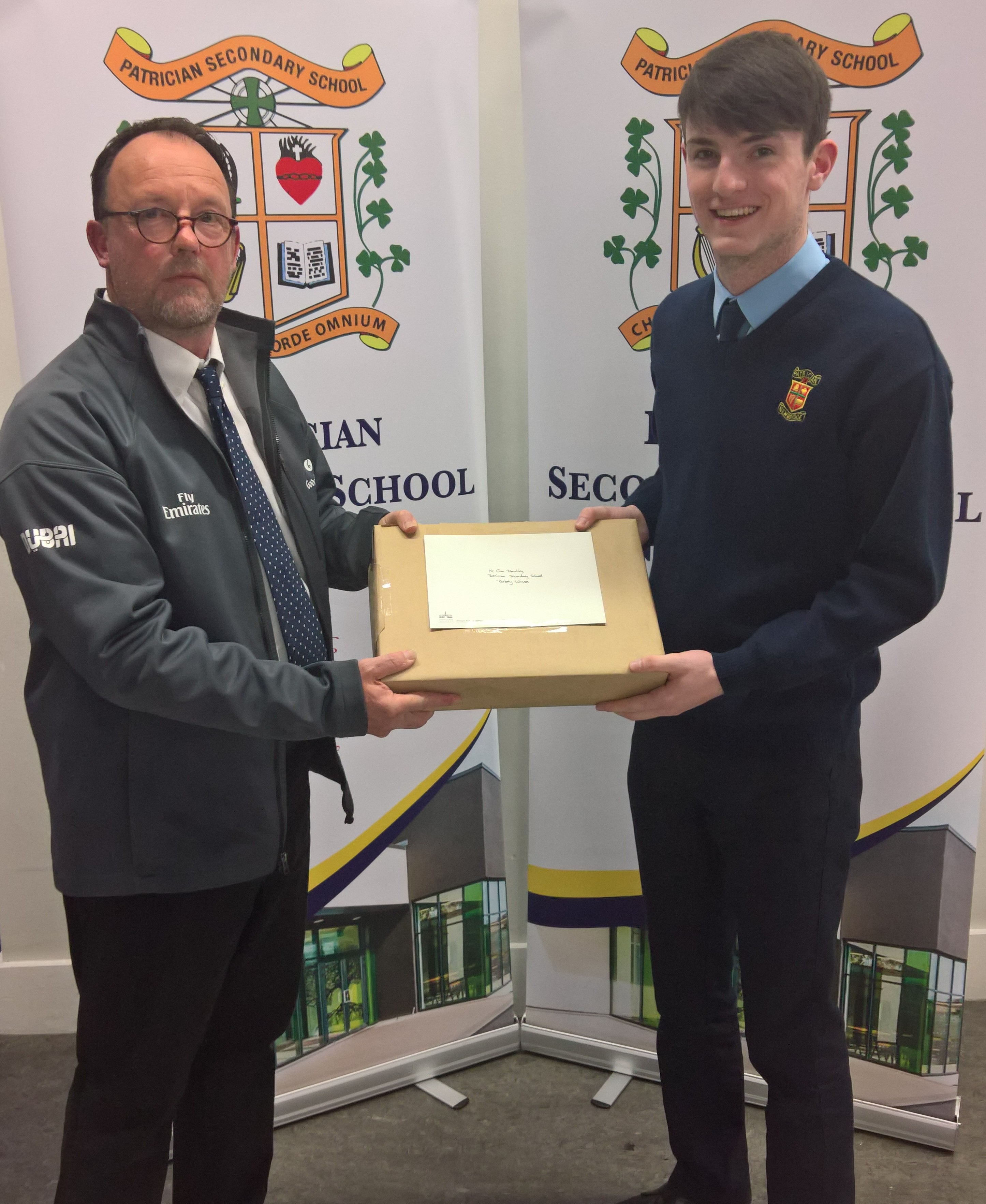 Old Connell Stud's David Brophy presents Cian Dowling with his prize of a new laptop sponsored by Darley