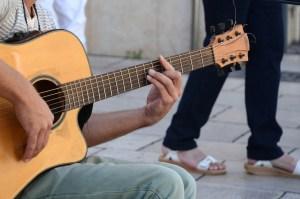Man playing his guitar