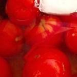 tomatoes peeling in water