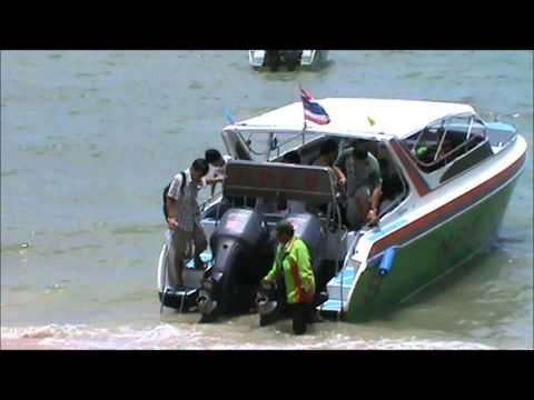 Thai Velocity Boats unloading Tourists on Pattaya Seaside
