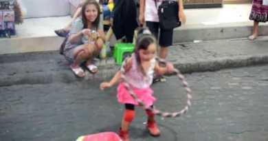 Cute younger girl Hula Hoop (Walking Boulevard Pattaya)