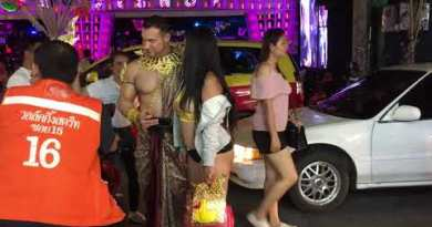 The Rock and his Thai Vital other – Walking Avenue after Wearisome evening Pattaya Thailand