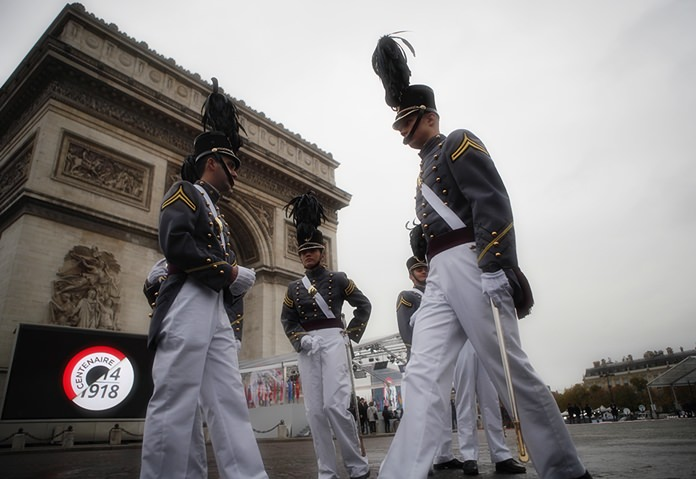 Cadets form the New York military academy wait near the Arc de Triomphe Sunday, Nov. 11, 2018 in Paris. (AP Photo/Francois Mori, Pool)