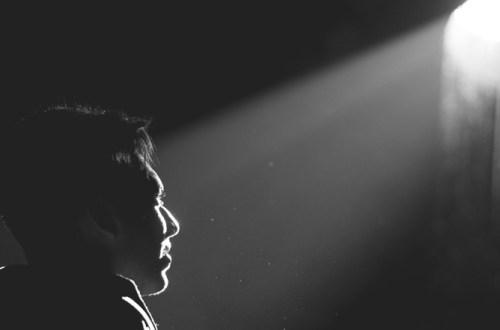 Man looking up at light