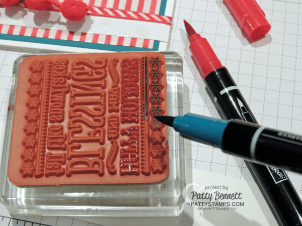 Use Stampin' Write markers to selectively color a portion of the Six Sayings hostess stamp from Stampin' Up!.  Happy Holidays penguin card by Patty Bennett