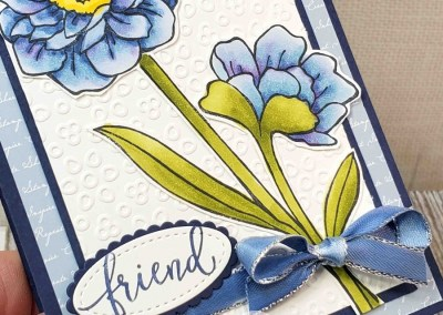 Band Together blue flower card with Eyelet Lace embossing folder