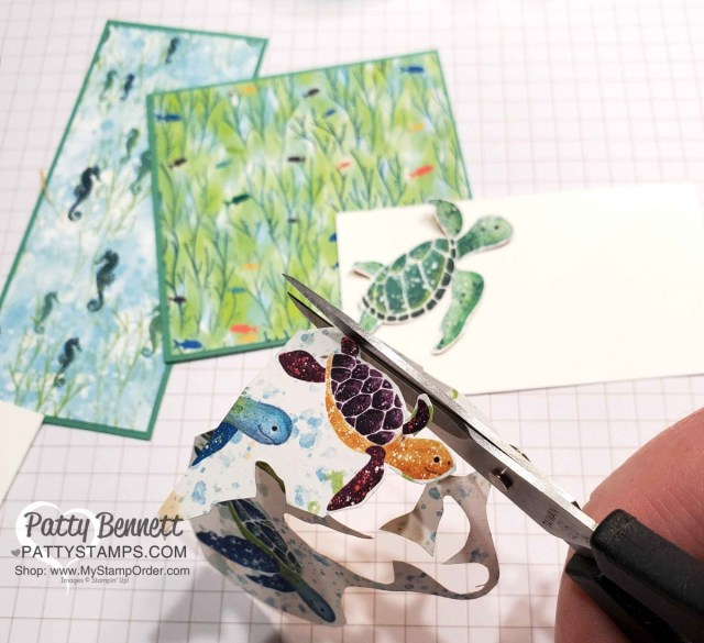 Use Paper Snips to fussy cut turtles from designer paper. Stampin' Up! Whale of a Time Suite products featured in this birthday card with turtles and Seabed embossing folder.