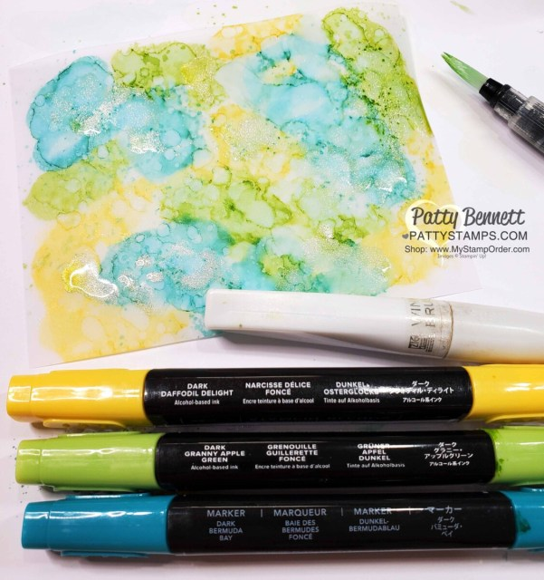 Alcohol ink background with Stampin' Blends markers, vellum and Wink of Stella.