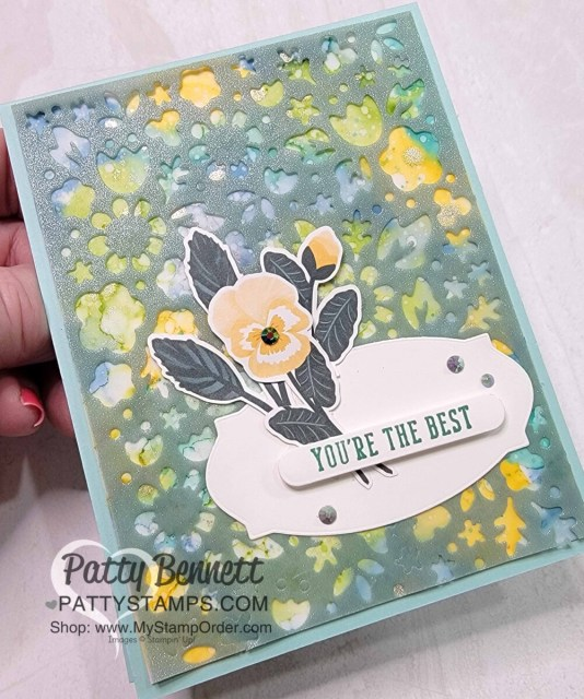 Flower Market die with Shimmer Vellum from Stampin' Up!, overlayed on Alcohol ink background.  Pansy Petals die cut flower focal point. Card by Patty Bennett