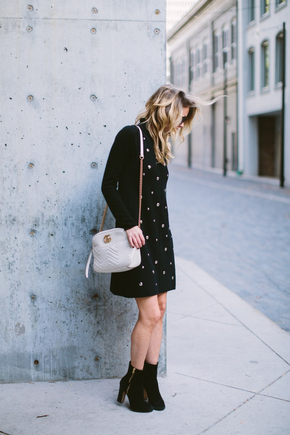 TOPSHOP Dome Stud Dress, Gucci bag, Dee Keller booties and Illesteva sunglasses on PAULARALLIS.COM