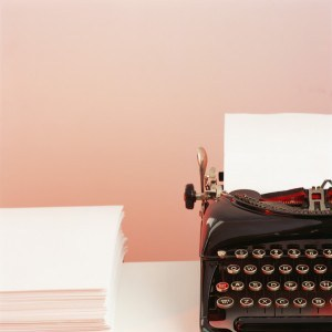 Typewriter and stack of paper
