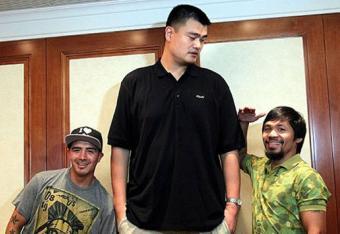 Brandon-Rios-left-and-Manny-Pacquiao-meet-a-Sentinel-Chris-Farina-Top-Rank_crop_north