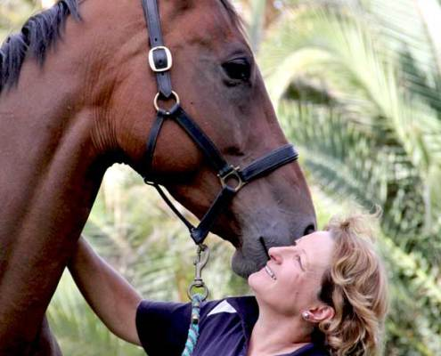 Image of Carolyn Buckland with her horse