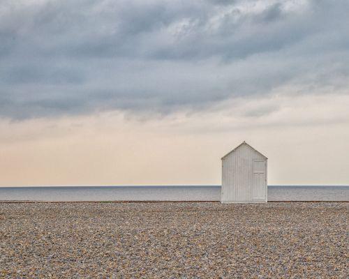 Lone beach hut (right)