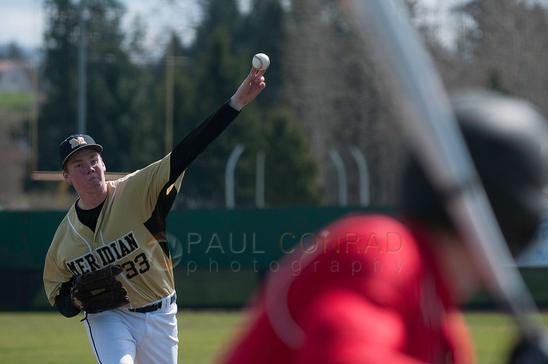 © Paul Conrad/ Pablo Conrad Photography - Meridian Trojan boys against the Brewster Bears at Meridian High School in Bellingham on April 2, 2014. Meridian lost 5-4.