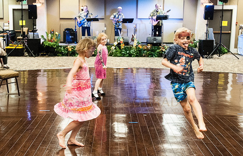 © Paul Conrad/The Bellingham Herald - Lexi White, 9, left, Emma Caires, 6, and Corban White, 7, all from Bellingham, dance to the music of Elias Kauhane (cq)  during the 3rd annual Bridge of Aloha Festival  in Ferndale, Wash., at the Ferndale Events Center on Saturday afternoon May 3, 2014. The annual festival is a celebration of  Hawaiian culture.