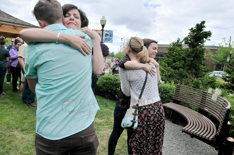 © Paul Conrad/The Bellingham Herald - Hannah Dashiell's mother Jeannette Dashiell hugs Alex Powell, left, as Hannah's sister Maddy Dashiell hugs Lindsey Dunning during the Hanna Dashiell Bench Dedication at Barkley Village on Saturday afternoon June 28, 2014, in Bellingham, Wash. Powel and Dunning were close friends with Hannah. Dashiell died in a motor vehicle accident in early January of this year. A memorial scholarship has been setup by the Whatcom Community Foundation in her name for high school girls pursuing a career in the medical field.