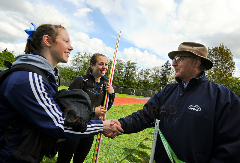 © Paul Conrad/The Bellingham Herald - Western Washington University sophomores Katie Reichert, left, of Kelso, Wash., and Bethany Drake of Sandy, Ore., chat with retired WWU coach Ralph Vernacchia during the 2014 Ralph Vernacchia Track and Field Meet at Civic Field in Bellingham, Wash., on Saturday April 26, 2014. The annual event is named after the retired coach.