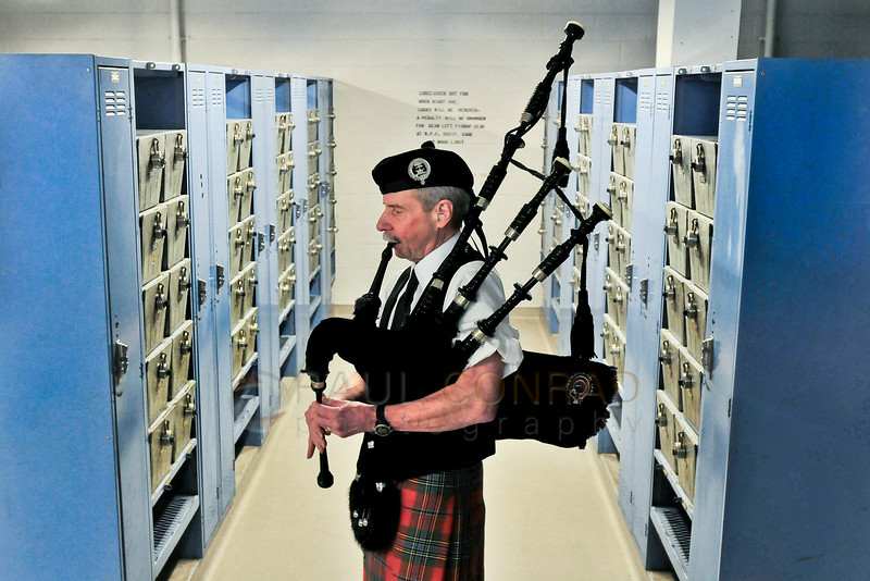 © Paul Conrad/The Bellingham Herald - Bellingham Pipe Band member Gary Griffiths practices in the men's locker room during commencement services for graduating Western Washington University students in Carver Gymnasium at Western Washington University on Saturday morning June 14, 2014, in Bellingham, Wash.