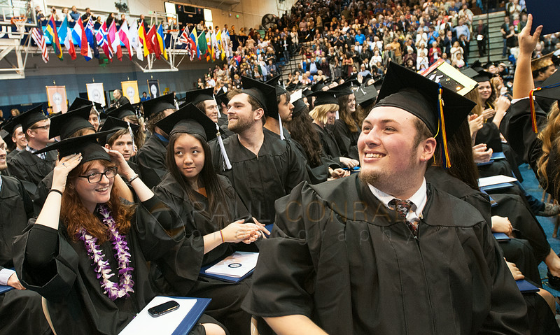 © Paul Conrad/The Bellingham Herald - Gavin Annette, right, of Federal Way, Wash., smiles towards his family at the end of commencement services for graduating Western Washington University students in Carver Gymnasium at Western Washington University  on Saturday  morning June 14, 2014, in Bellingham, Wash.