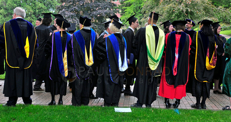 © Paul Conrad/The Bellingham Herald - Professors and school officials line the walkway as students drop off their IDs and unpaid parking tickets after commencement services at Western Washington University on Saturday  morning June 14, 2014, in Bellingham, Wash.