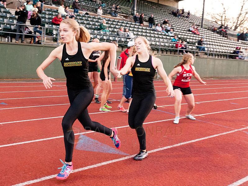 © Paul Conrad/ Pablo Conrad Photography - Sehome's Girls hand off during the final lap of the 4x400m relay during NWC track & field meet at Civic Field and Stadium in Bellingham, WA. Sehome won second place with a time of 4 mins, 8.1 secs.