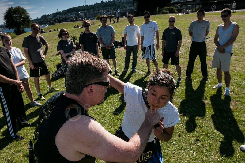 © Paul Conrad/Pablo Conrad Photography - Arjhan David Brown , left, and Kru Yai Katherine Holmes demonstrate one knife fighting technique at Gasworks Park in Seattle, Wash.