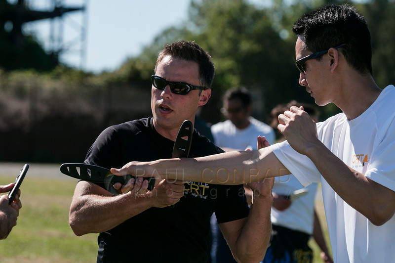 © Paul Conrad/Pablo Conrad Photography - Sifu Cory Walken, left, with Seattle Close Range Tactics demonstrates proper defensive techniques at Gasworks Park in Seattle, Wash.