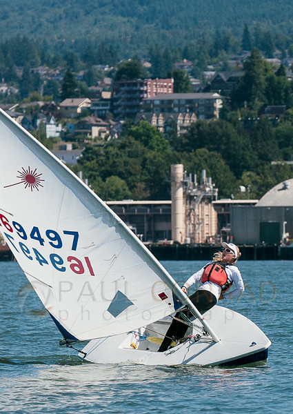 © Paul Conrad/The Bellingham Herald - Eliza Dawson of Port Townsend leans hard while tacking during the second race of the Laser class during the annual Bellingham Youth Regatta on Saturday afternoon August 9, 2014, on Bellingham Bay in Bellingham, Wash. Dozens of youth from ages 6 and up raced in 5 categories.
