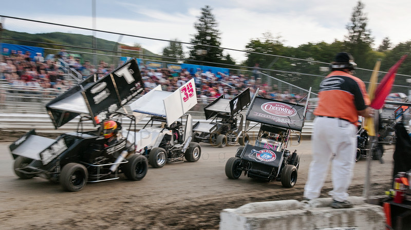 Michael Faccinto (7J) leads the pack around turn 1 as Spud Allen (right) begins to lose control during the 600 division race of the 2014 Clay Cup Nationals at Deming Speedway in Everson, Wash.,  on Thursday evening July 17 , 2014.  The Clay Cup Nationals mini sprint  races continue through Saturday July 19th.