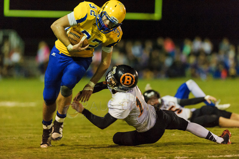 Blaine defensive back Alfonso Dermendziev (14), right, misses as he attempts to tackle Ferndale running back Austin Honeycutt (32) as he pushes past the line of scrimmage for a gain of yardage during the second quarter at Ferndale High School in Ferndale, Wash., on Friday evening Sept. 18, 2015.