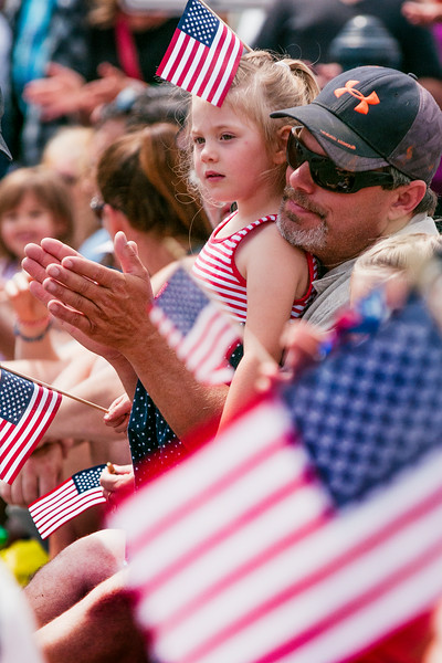 © Paul Conrad/The Bellingham Herald - Barry Dyck (cq) of Bellingham and his daughter Piper, 4, cheer as the floats pass by during the Old Fashioned 4th of July parade in Downtown Blaine, Wash.,  on Friday July , 2014. Thousands lined Peace Portal Drive to watch almost 100 floats pass by in this year's parade.