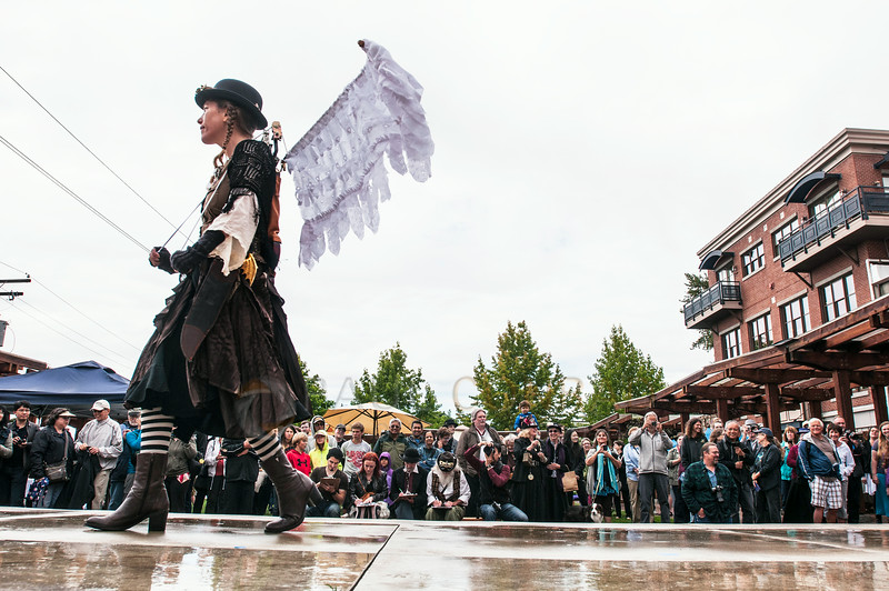 © Paul Conrad/The Bellingham Herald - Shell Philhower crosses the stage during costume constest the Fairhaven Steampunk Festival at Fairhaven Village Green in Fairhaven, Wash.,  on Saturday afternoon July 19, 2014. Philhower says her costume took over 2 months to create and calls it her