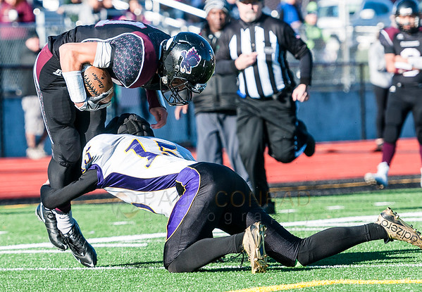 Lummi's Free Borsey (11) is stopped short of the goal by Quilcene's Eli Harrison (15) during the first quarter in the 1B state quarterfinals on Saturday afternoon Nov. 21, 2015, at Lummi Nation School in Lummi, Wash. Lummi went on to defeat Quilcene 40 to 0 to advance to the semi-final. (© Paul Conrad/The Bellingham Herald)
