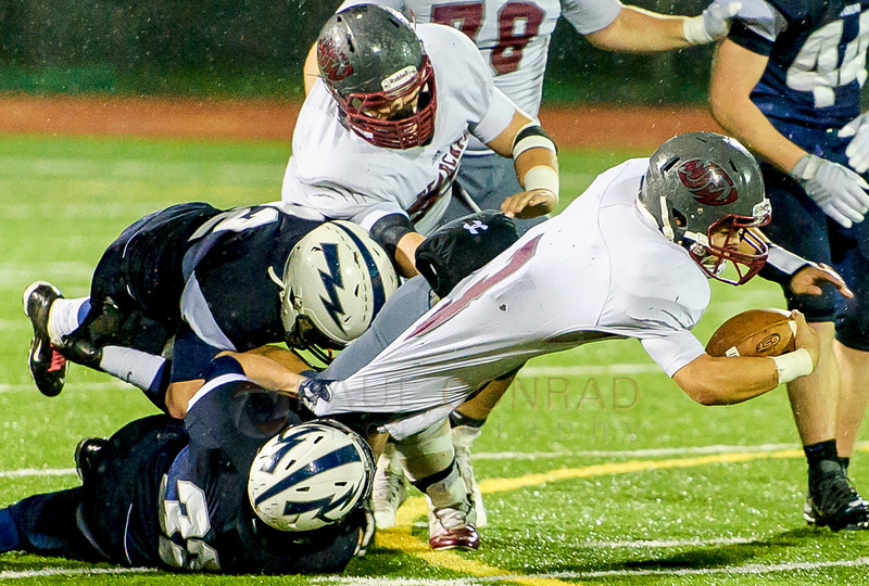 Squalicum's Brian Pullman (22) and Will Nickleson (32) tackle WF West's Elijah Johnson (3) at the line of scrimmage during the third quarter in the first round of District 2A State Playoffs on Saturday evening Nov. 14, 2015, at Civic Field in Bellingham, Wash. Squalicum defeated WF West 31 to 29.