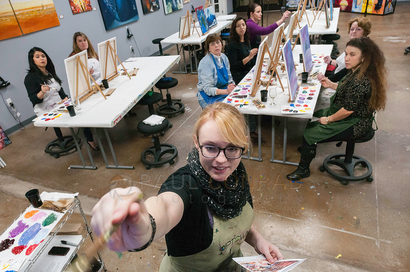 © Paul Conrad/The Bellingham Herald - Senior instructor Amy Hill of Bellingham, Wash., demonstrates a brush stroke technique while teaching a class at Uptown Art painting studio on Bellwether Way in Bellingham, on Friday evening December 5, 2014.