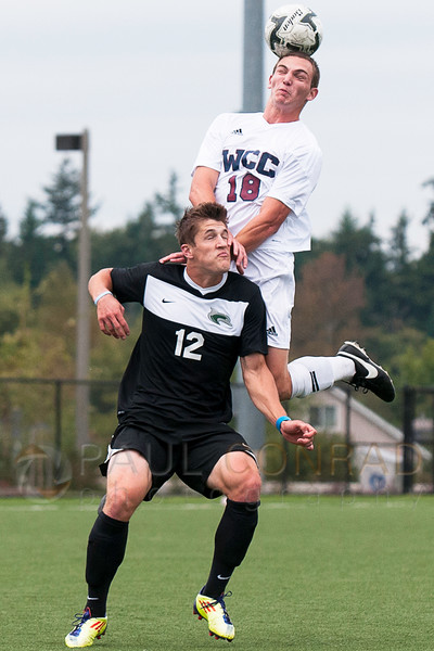© Paul Conrad/The Bellingham Herald - Whatcom Community College freshman forward Canyon Silliman (18) goes above Shoreline Community College jufreshman defensiveman Ryan Anderson (12) during the first half on Orca Field at Whatcom Community College in Bellingham, Wash., on Saturday afternoon Oct. 4, 2014. The visiting Shoreline Dolphins defeated the WCC Orcas 1 to 0 by a last minute second half goal.